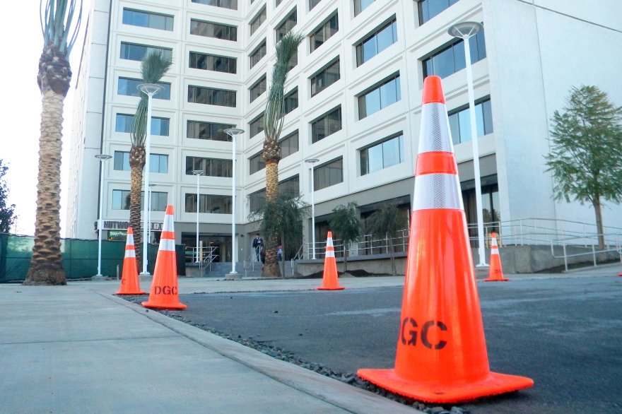 Cones line recently the recently paved cement in front of College Park
