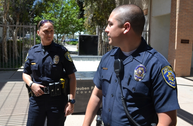 Officer Hollyfield, left, and Officer Bridgewaters catch up after a medical aid call.