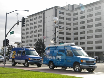 News vans park in front of Cal State Fullerton on December 13, 2012, the day after the lockdown.