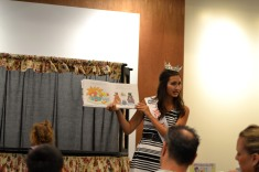 Carly Valez, Miss Placentia 2013, reads a book for a children's storytime
