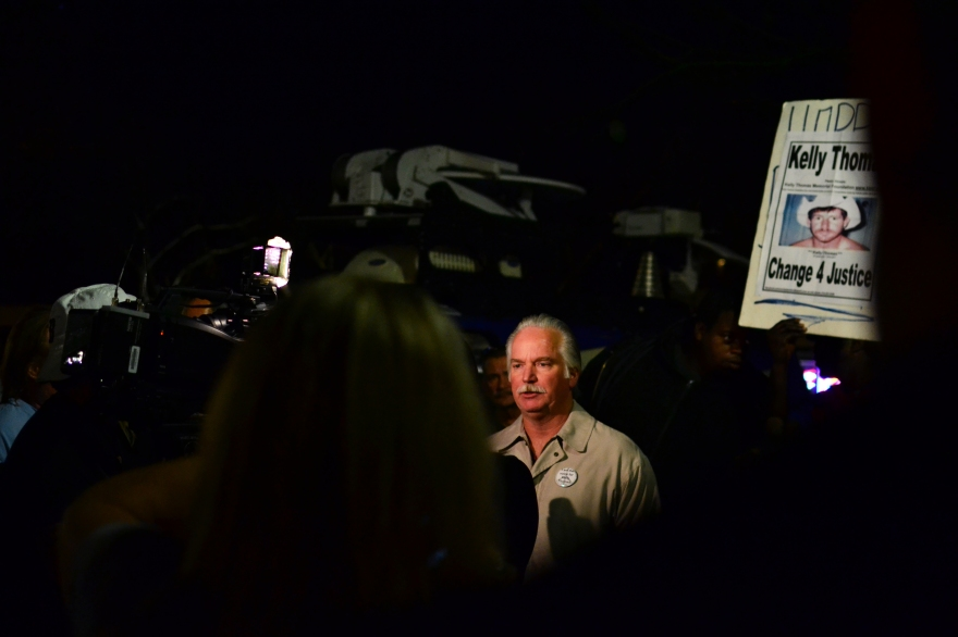 Ron Thomas, father of Kelly Thomas, speaks to the media in downtown Fullerton on Monday night.