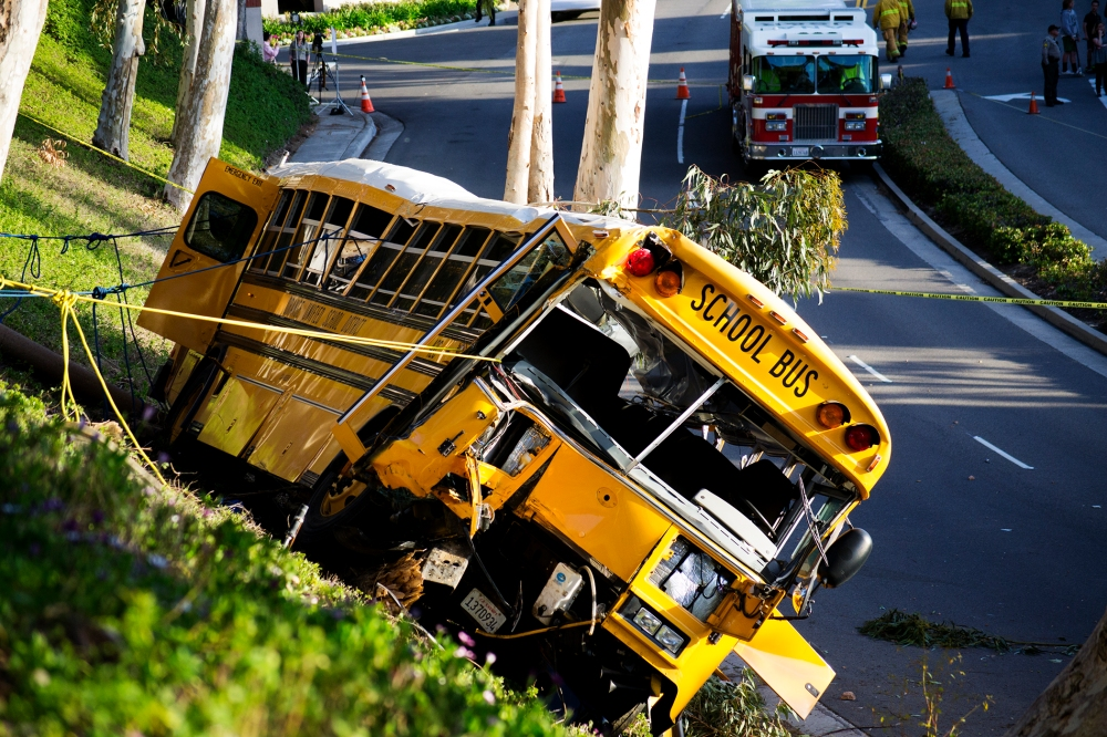 An Orange Unified School District bus rests a few feet up a hill after it crashed in Anaheim Hills on April 24, 2014.