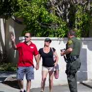A Sheriff's officer talks to residents who were affected by the power outage.