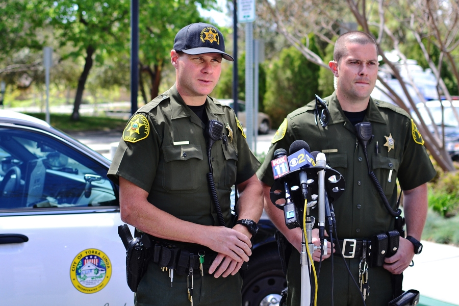 OC Sheriff's deputies Robert Miranda, left, and his partner Zack Bieker talk to the media following their release from the hospital on the afternoon of Tuesday, April 1, 2014.