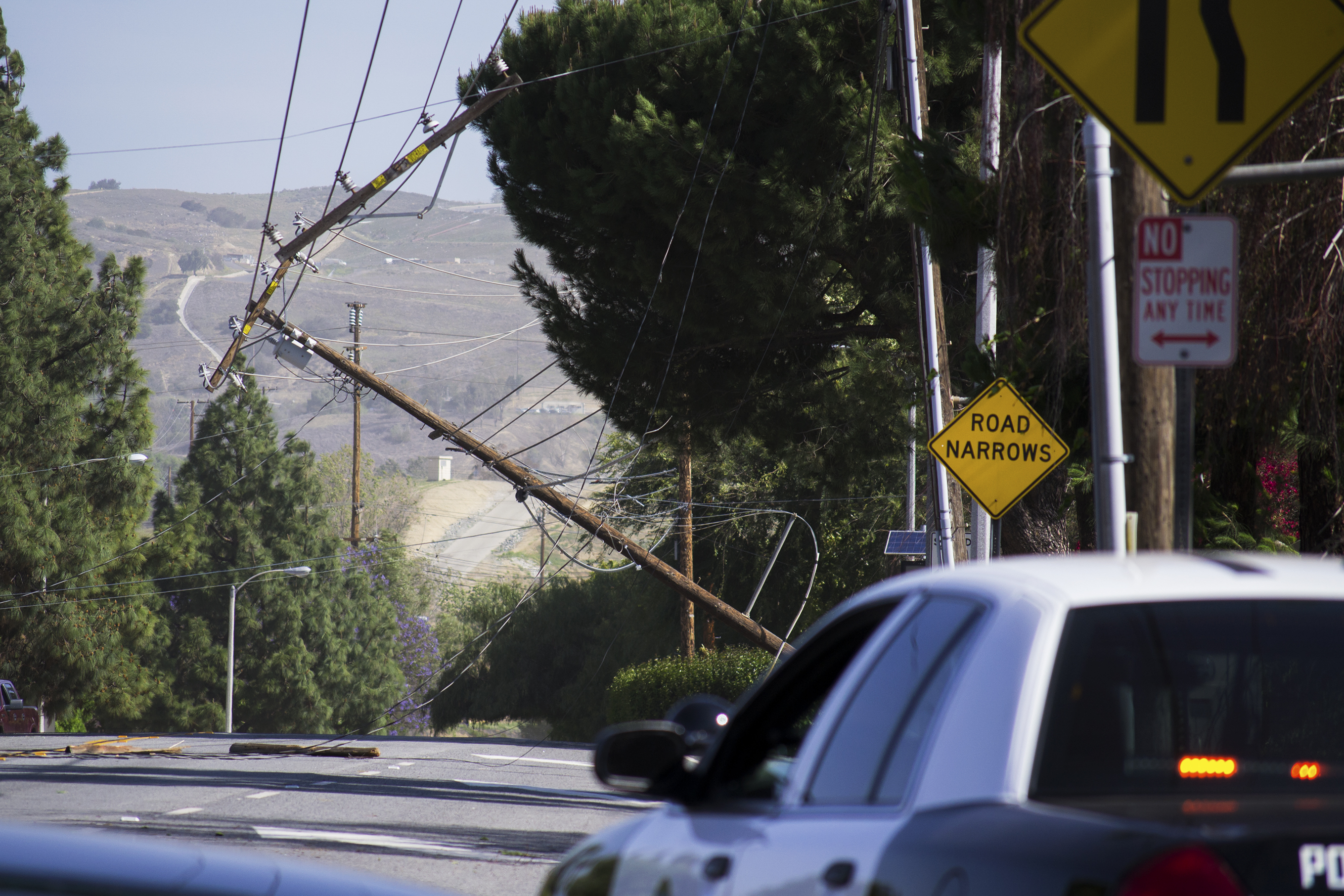 A downed power line leans over Rose Drive in Yorba Linda on Tuesday morning, April 29, 2014.