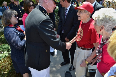 Lt. Gen. John Toolan, the commander of the 1st Marine Expeditionary Force, greets a man who said he was a Marine at the Memorial Day ceremony.