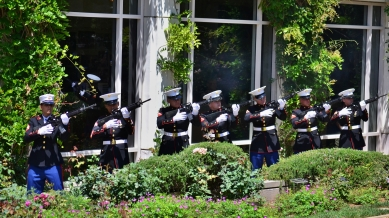 Marines take part in a 21-gun salute at the Nixon Library's Memorial Day ceremony