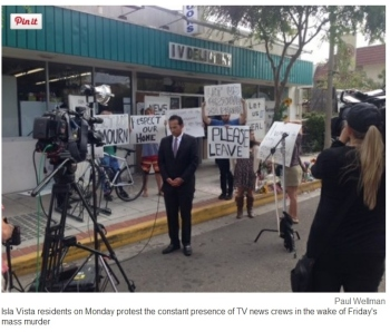 A screenshot of a Santa Barbara Independent photograph by Paul Wellman showing Isla Vista residents protesting the constant presence of TV crews in the area, according to the photo's caption.