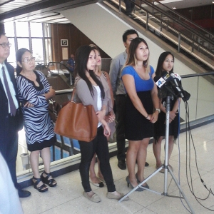 Friends and family of Kim Pham speak at a news conference to show their support for Kim on Wednesday, July 9, 2014.