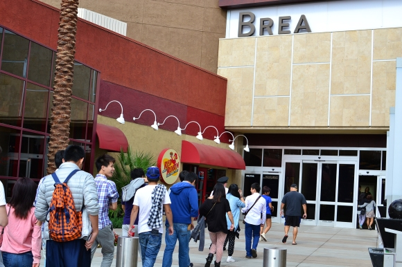 Apple customers enter the Brea Mall on Friday, Sept. 18.