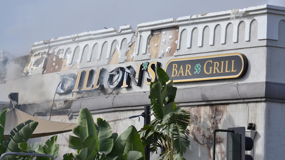 Fire damage on the Dillon's Bar and Grill sign.