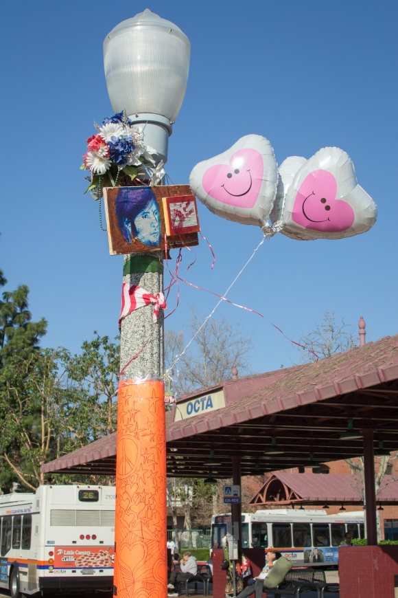 Valentine's Day-themed balloons decorate the Kelly Thomas memorial in downtown Fullerton in February 2015.