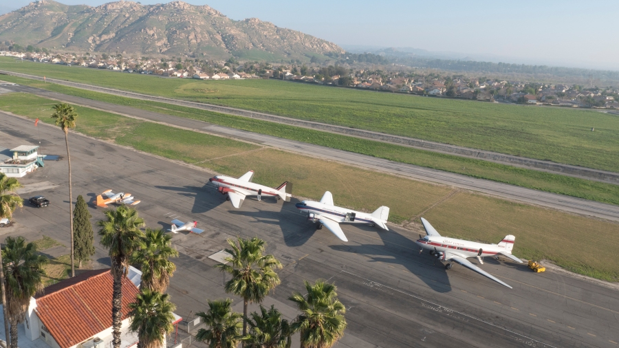 A lineup of three DC-3 antique airplanes is showcased at an airport in Southern California in February. Photographed for Vertical Prime. www.verticalprime.com